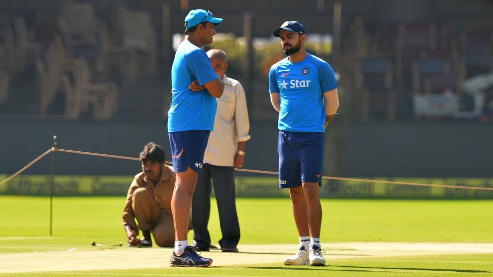 Indian coach Anil Kumble (L) and captain Virat Kohli (L) chat during a practice session prior to the second Test match between India and Australia. (AFP)