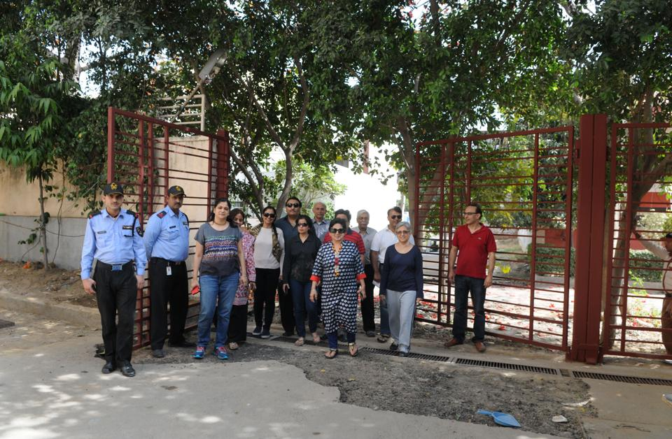Residents of The Ivy in Sushant Lok-1 stand in front of the gate that was opened after seven years of repeated pleas to authorities.