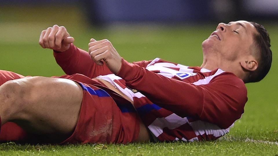 Atletico Madrid's forward Fernando Torres lies on the field during a Spanish league football match vs Deportivo de la Coruna at the Municipal de Riazor stadium in La Coruna on Thursday.