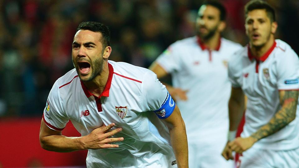 Sevilla's midfielder Vicente Iborra (left) celebrates after scoring against Athletic Bilbao during their Spanish La Liga match at the Ramon Sanchez Pizjuan stadium on Thursday.