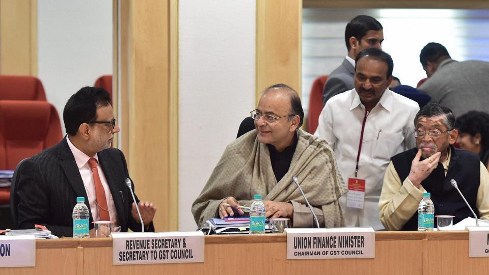 Finance minister Arun Jaitley with revenue secretary Hasmukh Adhia at a GST council meeting in New Delhi.