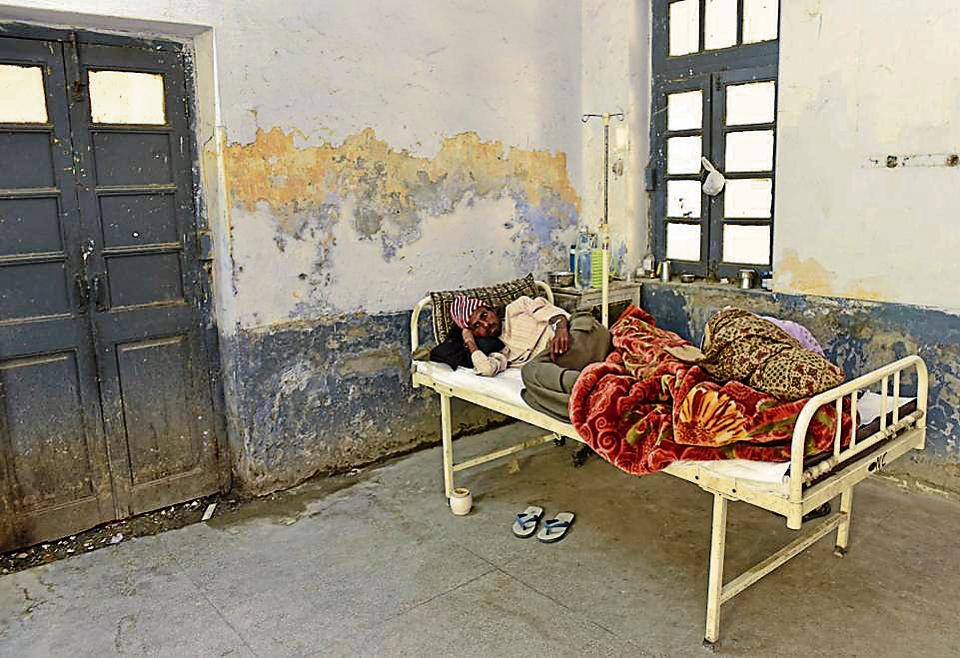 A patient lying on a bed amid pathetic conditions.