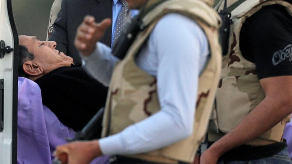 Former Egyptian President Hosni Mubarak lies on a stretcher after getting back from his trial to the military hospital in Cairo in Egypt.