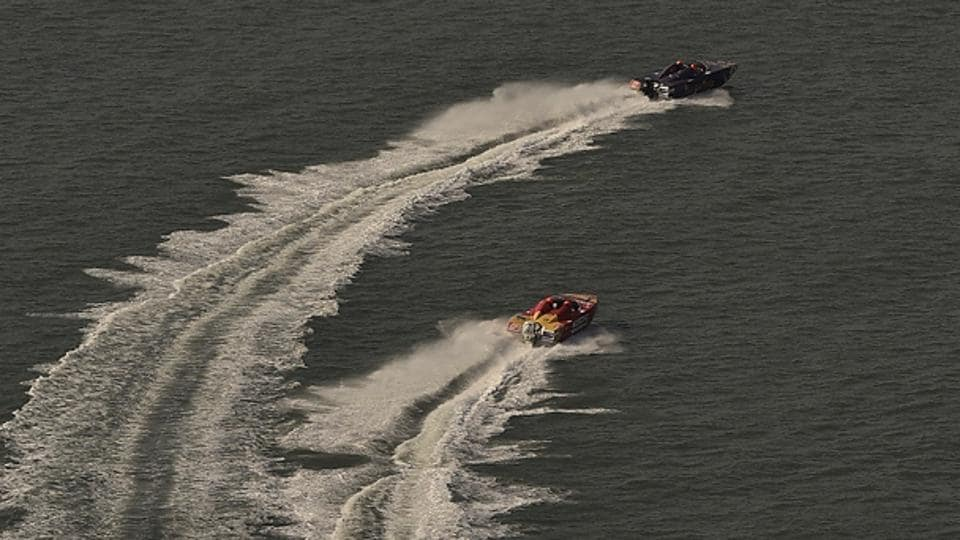 Panther boats cut through the water near Mumbai's Marine Drive during the qualifiers of the NEXA P1 Powerboat race in Mumbai. (Arijit Sen/HT Photo)