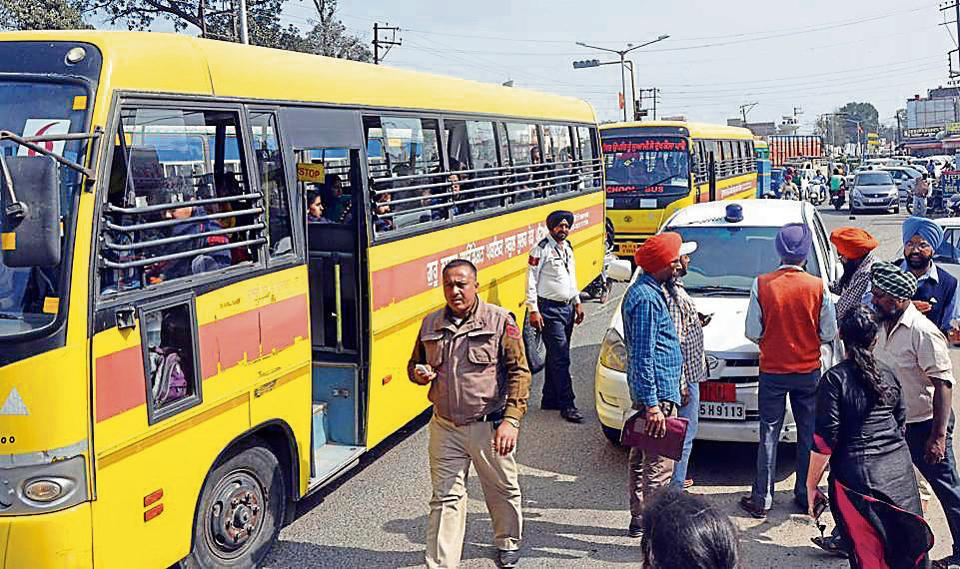 DTO officials challaning school buses in Patiala on Friday.