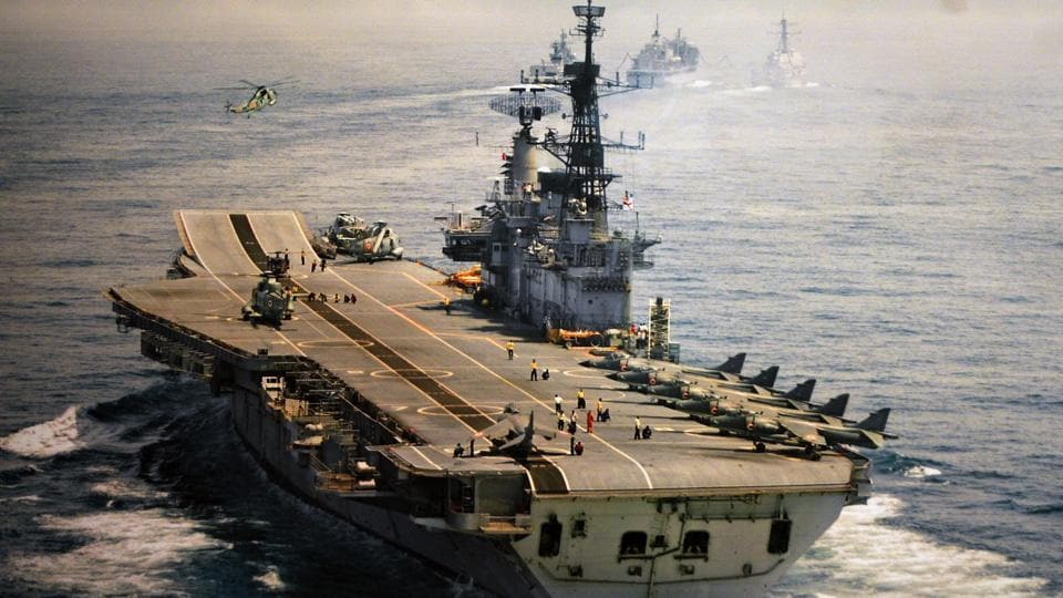 An old undated photograph of INS Viraat at sea with its deck lined up with jets and choppers. The iconic Indian aircraft carrier will be decommissioned officially today at a ceremony in Mumbai. We look back at some images of the ship in action over the last few decades. (PIB)