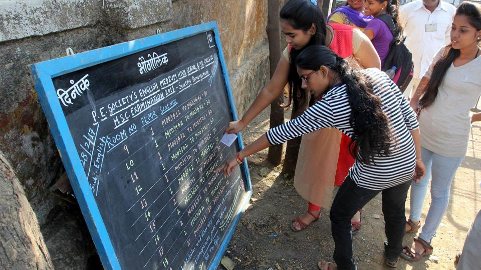 Students appearing for HSC exams check their roll numbers at an exam centre in Thane.