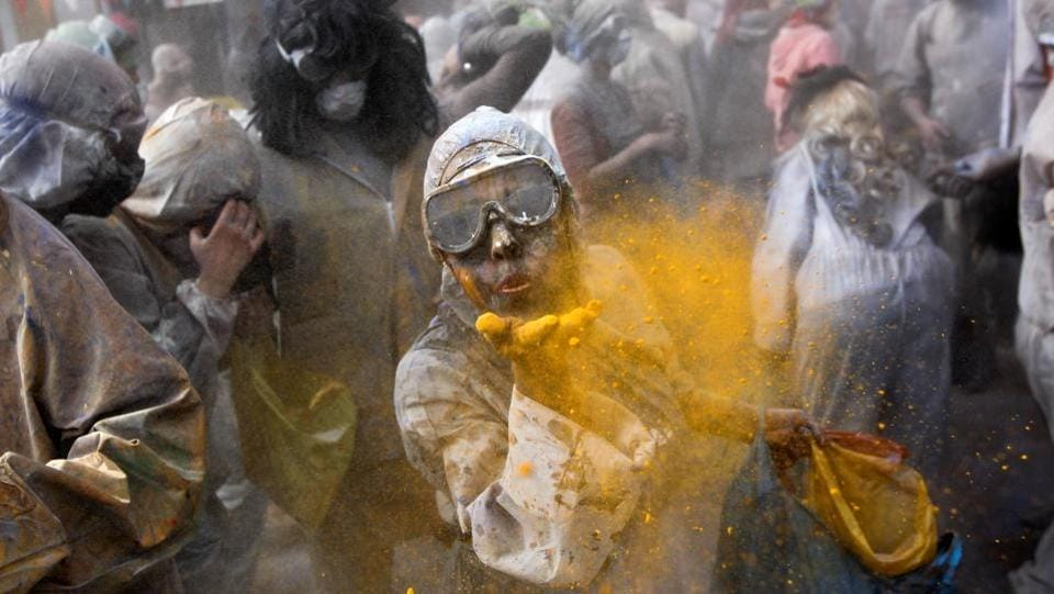 Revellers celebrate 'Ash Monday' by participating in a colourful