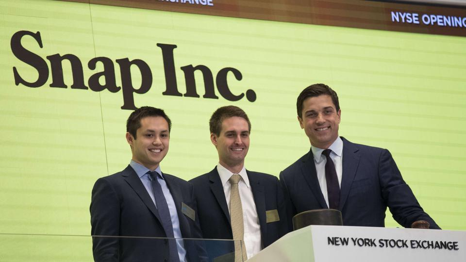 Snapchat co-founders Bobby Murphy(L)  and Evan Spiegel(C) prepare to ring the opening bell as Thomas Farley, president of the NYSE, looks on.