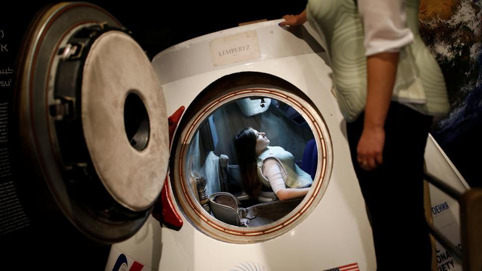 A woman wearing a prototype of Stemrad's new protective vest, Astrorad, sits inside Russian spacecraft, Excalibur-Almaz Space Capsule, during a demonstration for Reuters, at Madatech, National Museum of Science Technology and Space in Haifa, Israel. (Amir Cohen / REUTERS)