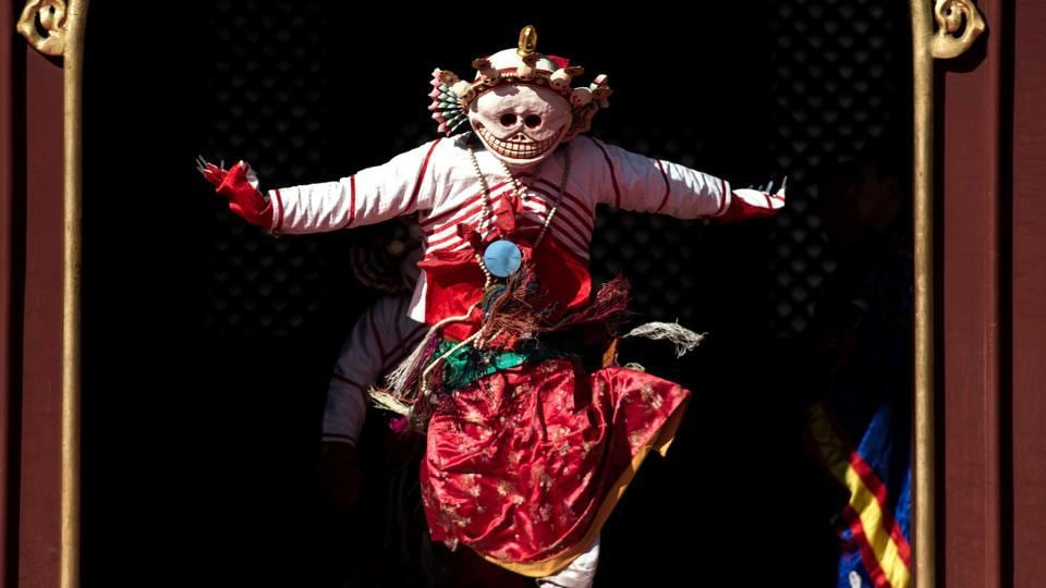A Tibetan monk dressed as a demon performing a dance for the Beating Ghost festival during a rehearsal at the Yonghe Temple, also known as the Lama Temple, in Beijing. (Fred DUFOUR / AFP)