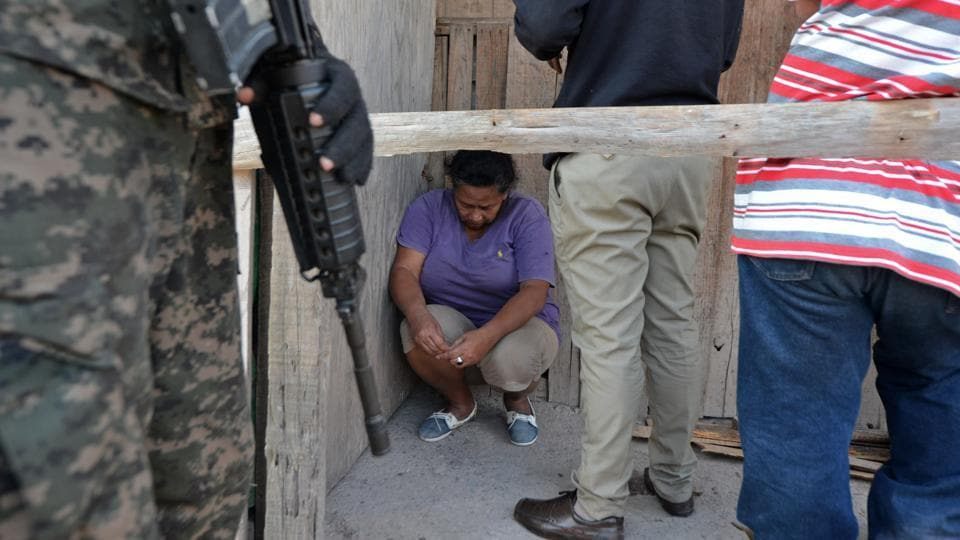 Alleged drug traffickers are arrested by Honduras' Military Police in Tegucigalpa, on February 24, 2017 during a raid as part of Morazan Operation to combat organized crime and insecurity in the country.  (Orlando SIERRA / AFP)