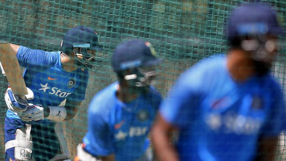 India's captain Virat Kohli, left, and teammates bat in the nets during a training session. (AP)