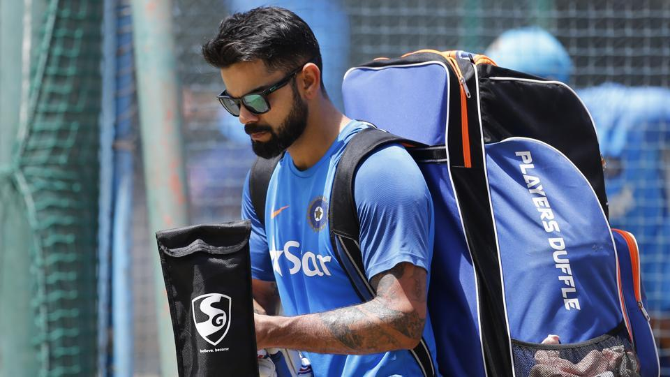 India's captain Virat Kohli leaves after batting in the nets during a training session ahead of their second cricket test match against Australia. (AP)
