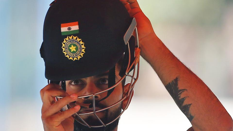 Virat Kohli prepares to bat in the nets during a training session ahead of their second cricket Test match against Australia in Bangalore.