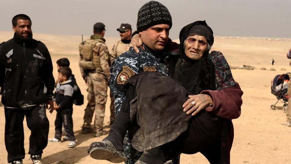 Carried across the desert by her grandsons, under sniper and mortar fire, she was one of thousands who braved the difficult and dangerous journey out of Islamic State's shrinking stronghold in the west of the city. (Zohra Bensemra/REUTERS)