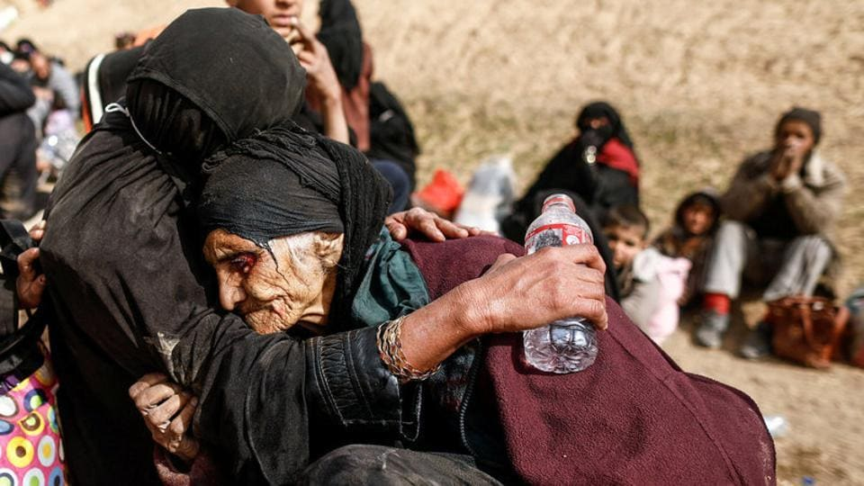 Khatla Ali Abdullah, 90, is embraced as she flees her home as Iraqi forces battle with Islamic State militants in western Mosul, Iraq. Ninety-year-old Khatla survived decades of turbulence in northern Iraq, but the frail grandmother who fled the battle for Mosul this week says the fighting there is the worst she has ever seen. (Zohra Bensemra/REUTERS)