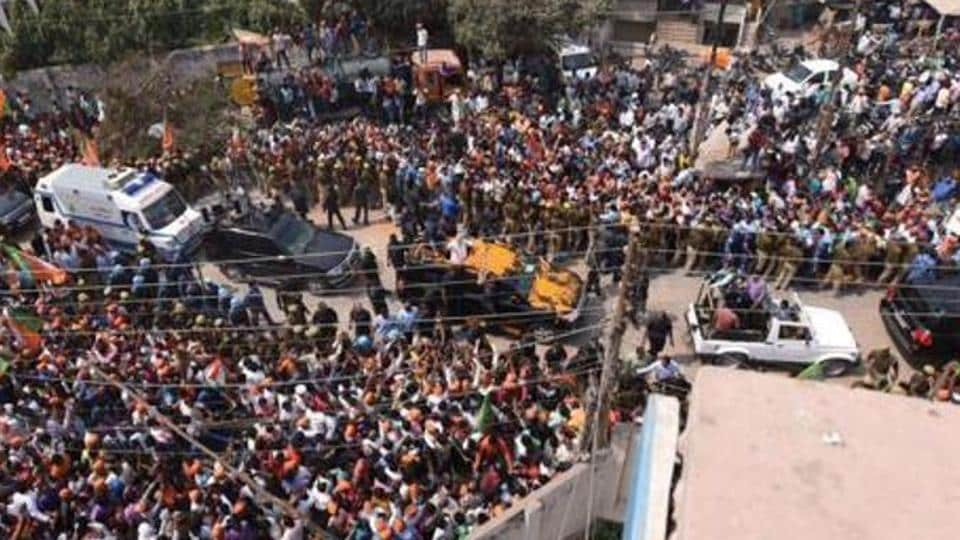 Massive crowd throng the streets of Varanasi as PM Modi's car passes through the city.