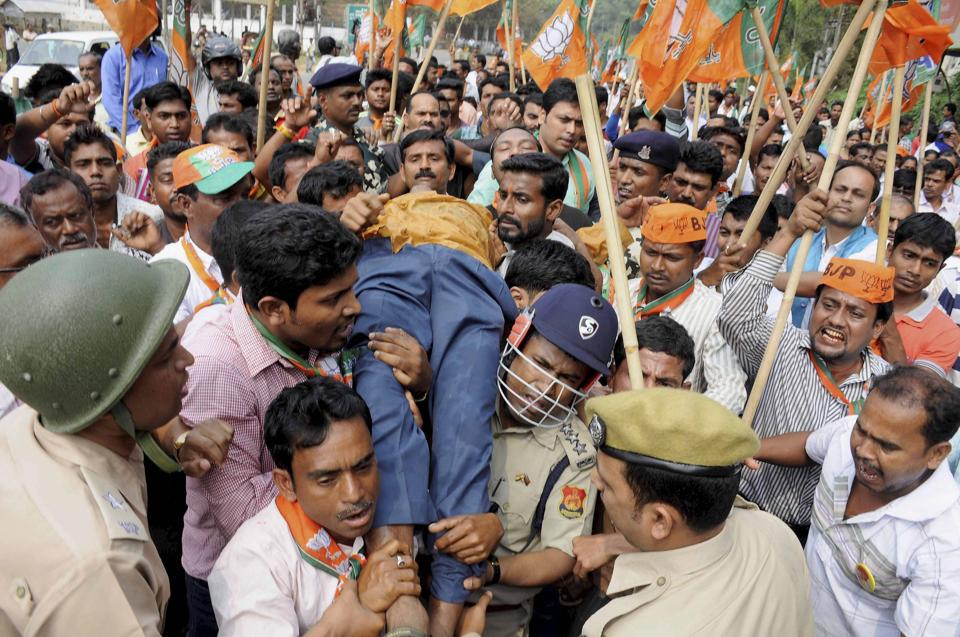 Fiel phot of an injured BJP supporter is carried for treatment after police action during a protest rally in Agartala .