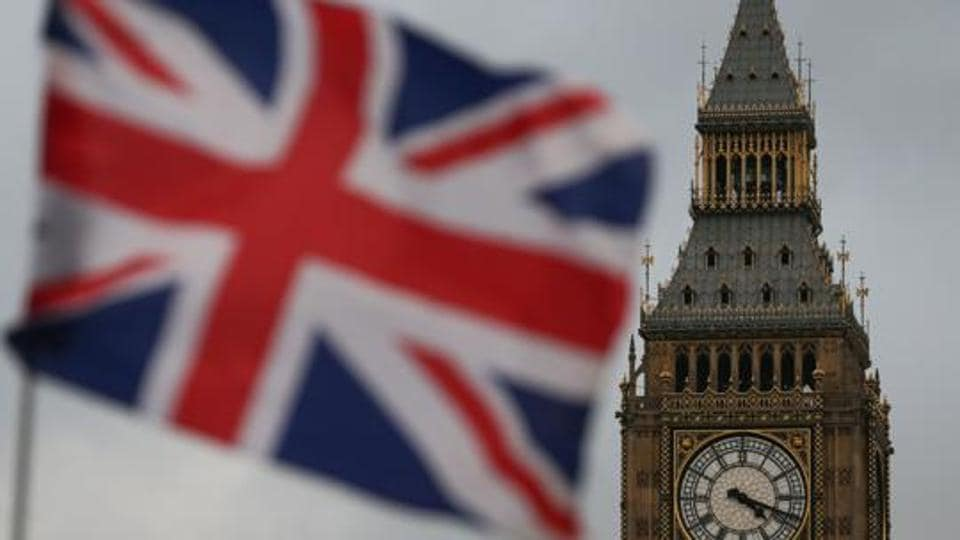 A Union flag flies near the The Elizabeth Tower, commonly known Big Ben, and the Houses of Parliament in London.