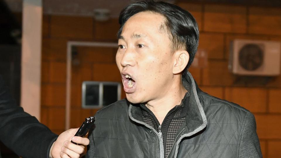 North Korean Ri Jong Chol speaks in front of reporters at the North Korean embassy in Beijing.