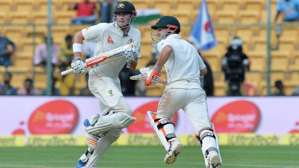 Australian batsmen David Warner (R) and Matthew Renshaw run between the wickets on Day 1 of the second Test in Bangalore on Saturday. Live streaming of Day 2 of India vs Australia will be available on Sunday.