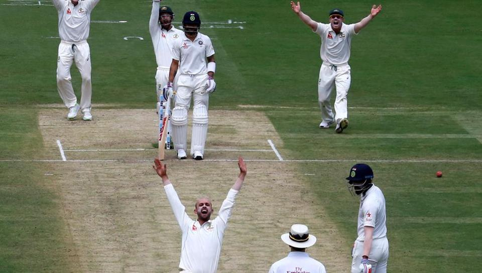 Australian players successfully appeal for the wicket of India's captain Virat Kohli in Bangalore on Saturday. Nathan Lyon got the all-important wicket of Kohli, who fell for 12. India were all out for 189.