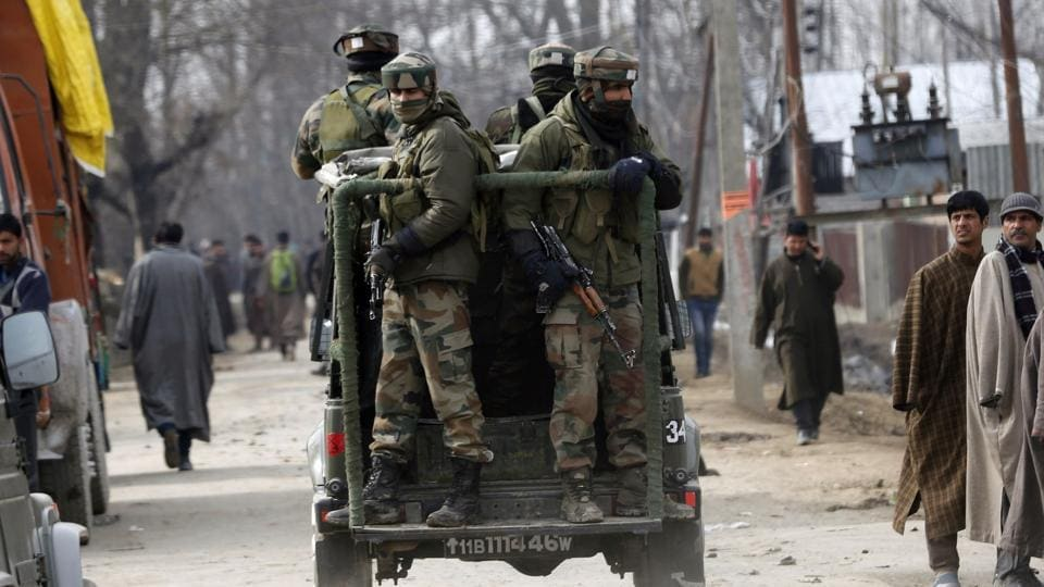 Soldiers travel in a vehicle after a gunbattle, north-east of Srinagar.
