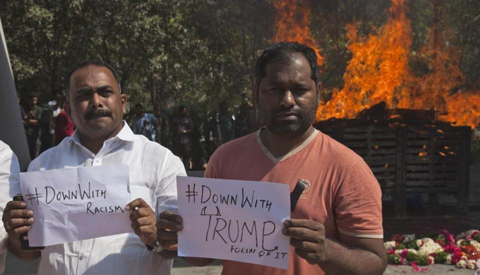 Indians hold placards in front of the cremation pyre of Srinivas Kuchibhotla, a 32-year-old engineer who was killed in a racially motivated shooting in a crowded Kansas bar, at a crematorium in Hyderabad on February 28.