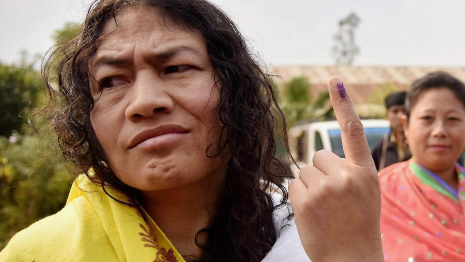Irom Sharmila shows her finger marked with indelible ink after casting her vote at a polling station in Imphal on Saturday.
