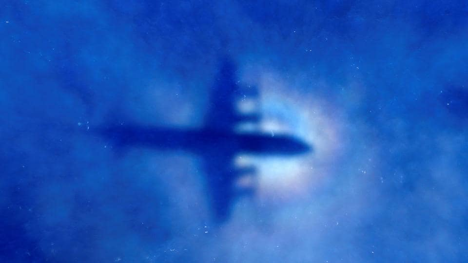 The shadow of a Royal New Zealand Air Force (RNZAF) P3 Orion maritime search aircraft can be seen on low-level clouds as it flies over the southern Indian Ocean looking for missing Malaysian Airlines flight MH370.