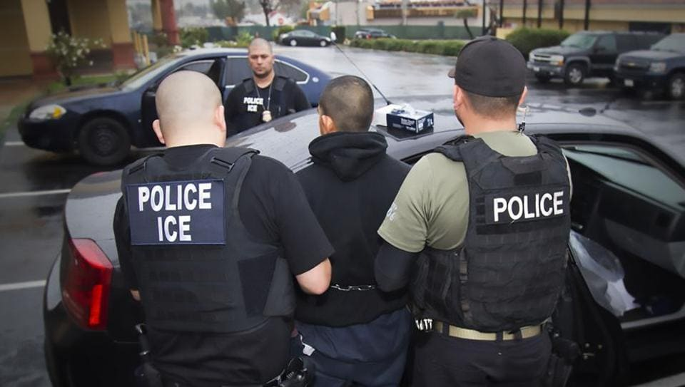 US Immigration and Customs Enforcement (ICE) officers detaining a suspect during an enforcement operation on February 7, 2017 in Los Angeles, California.