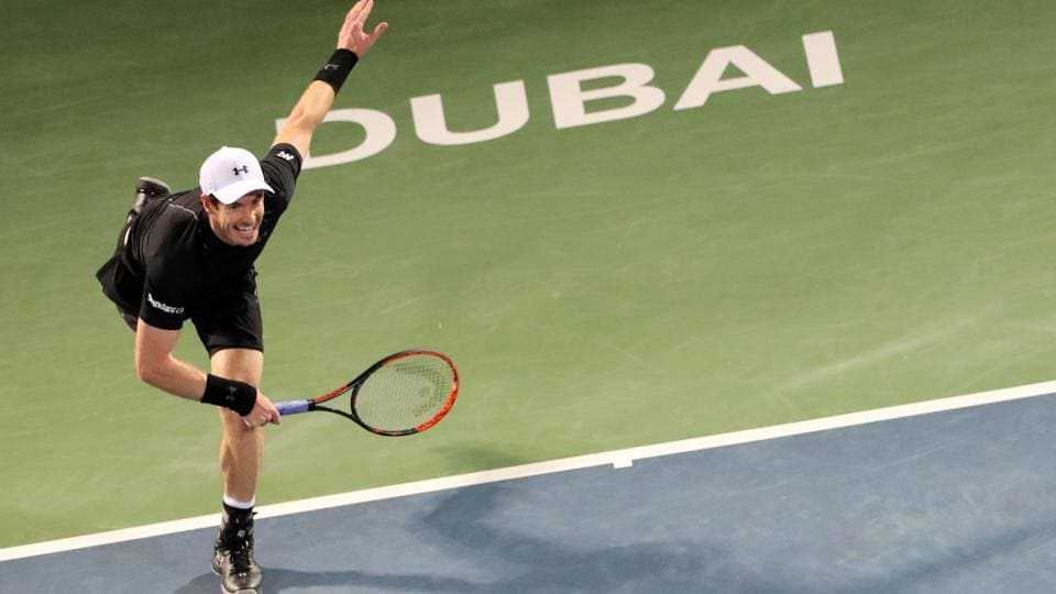 World number one Andy Murray of Great Britain returns the ball to France's Lucas Pouille during their ATP semi-final match in Dubai on Friday. He will meet Spain's Fernando Verdasco in the final match on Saturday.