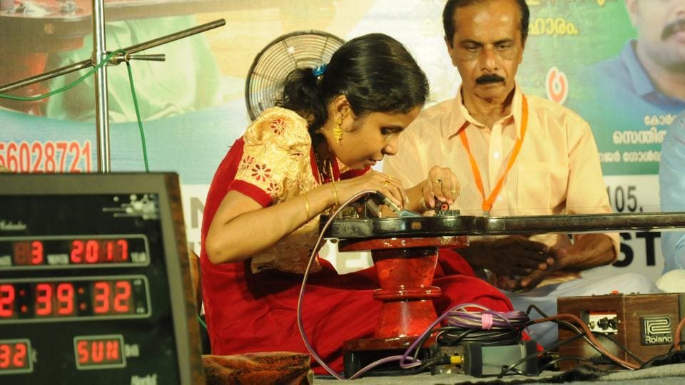 Vaikkom Vijayalakshmi, a visually impaired musician, playing her one-stringed Gayathri Veena in Kochi on Sunday where she set the new world record. She became an inspiration for girls after she called off her weddings two weeks ago because her fiance wanted her to stop performing music.