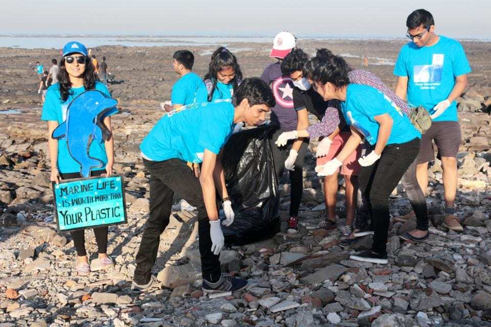 Students cleaning Chimbai beach at Bandra during a recent clean-up drive