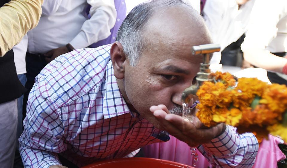 Delhi deputy chief minister Manish Sisodia drinks water from a tap after inaugurating the first 24x7 drinking water pilot project to provide quality drinking water straight from the tap at Malviya Nagar.