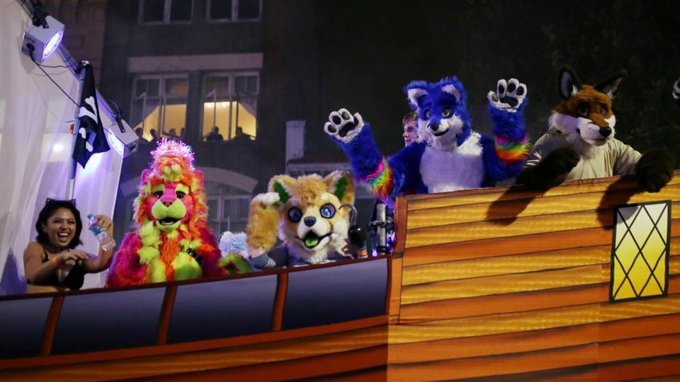 A float featuring participants dressed as furry animals pass  through the parade. This year the Australian Rules football league made history with the introduction of a national women's competition, which included the first openly gay players at the elite level. (Steven Saphore/REUTERS)