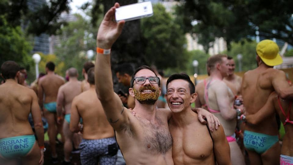 A couple takes a selfie during the festival. They instead favour a free vote in parliament, a move supported by many gay rights campaigners. For those enjoying the spectacle Saturday night, it was clear where their preference lay. (Steven Saphore/REUTERS)