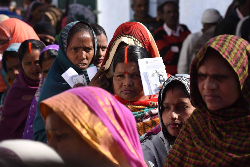 Voters line up to cast their votes at a polling station in Ayodhya. A total of 115 candidates, contesting the seventh and last phase of the Uttar Pradesh assembly elections, have criminal cases against them.
