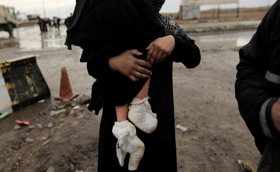 A displaced Iraqi woman carries her injured daughter after fleeing their home as Iraqi forces battle with Islamic State militants in western Mosul. The UN, which has been providing shelter, food and other assistance to Iraqis who have fled Mosul during the nearly five-month-long battle, said it is working as fast as possible to help those displaced. (Zohra Bensemra/REUTERS)