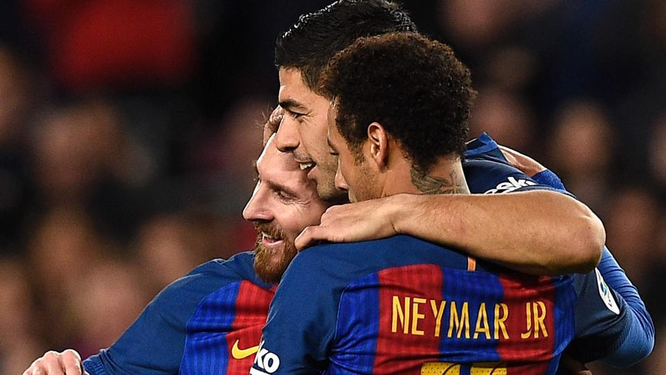 FC Barcelona's Lionel Messi (left) celebrates a goal with teammates Neymar (right) and Luis Suarez during their Spanish La Liga match against RC Celta de Vigo at Camp Nou on Saturday.