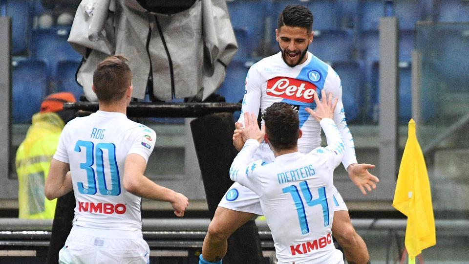 Napoli's forward Dries Mertens (C) celebrates with Lorenzo Insigne and Marko Rog (L) during the Italian Serie A football match.
