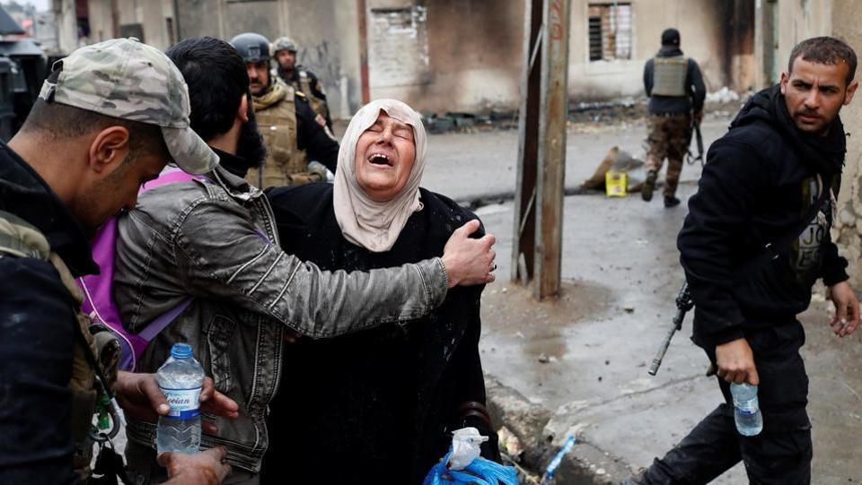 A woman cries after crossing from Islamic State controlled part of Mosul to Iraqi forces controlled part of Mosul. Tens of thousands of people have fled west Mosul since Iraqi forces launched an operation to retake it from the Islamic State jihadist group on February 19, pushing into the area from the south (Goran Tomasevic/REUTERS)
