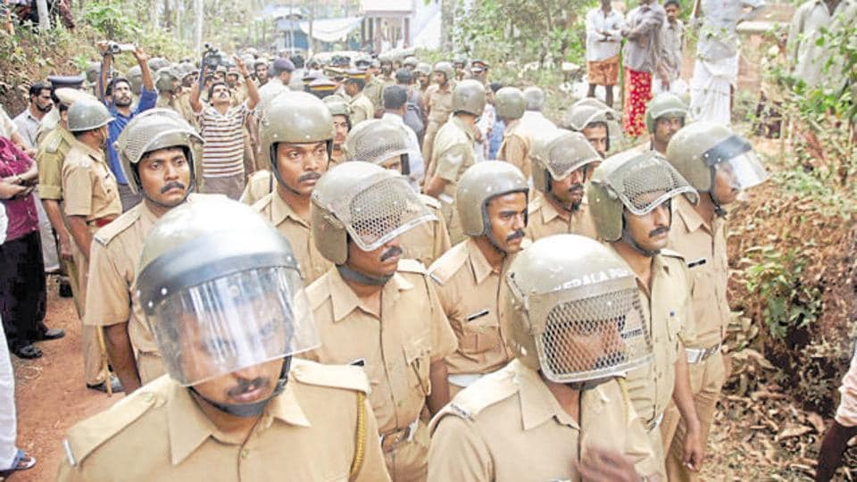 Kerala police on guars after violence in Kannur.