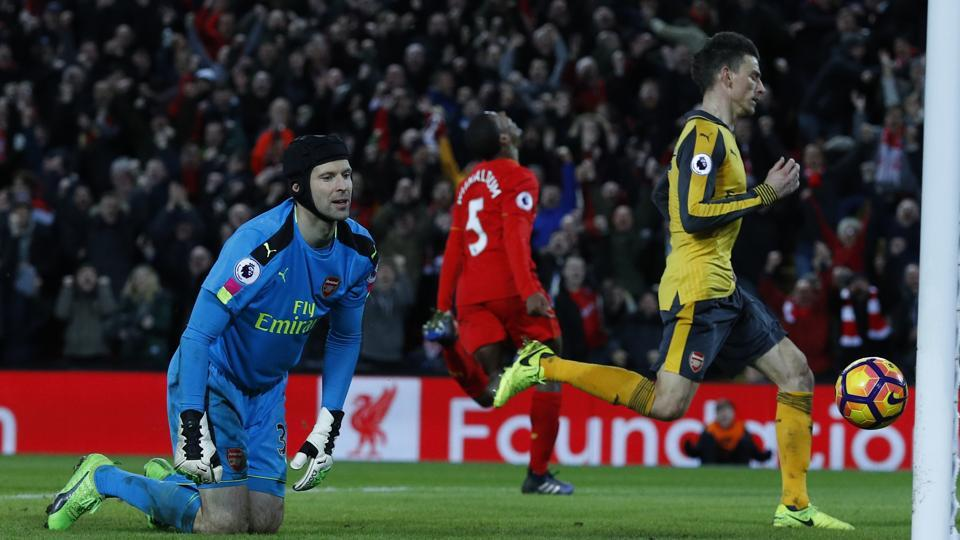Liverpool FC's Georginio Wijnaldum (centre)celebrates scoring their third goal past Arsenal FC's Petr Cech (left), inflicting more misery on under-fire Gunners manager Arsene Wenger.