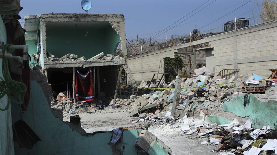 A home is surrounded by rubble from an explosion in the Mexico City suburb Tultepec on March 4.