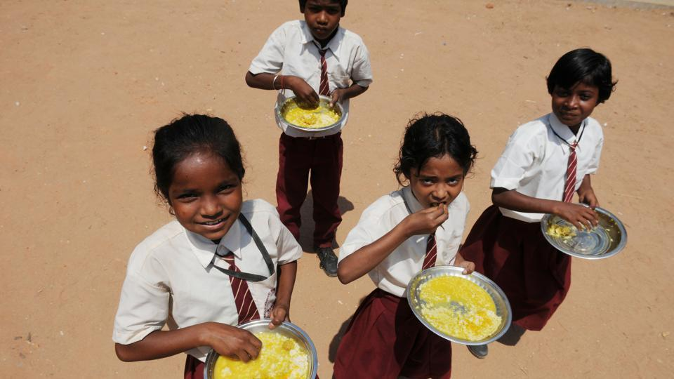 Students having Mid-day meals at Government Middle School at Tharpakhna in Ranchi