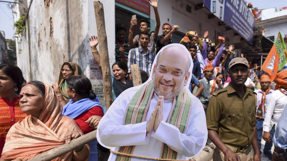 Supporters carry a cut-out of Amit Shah at prime Minister Narendra Modi's road show in Varanasi on March 4, 2017. (Arun Sharma/HT PHOTO)