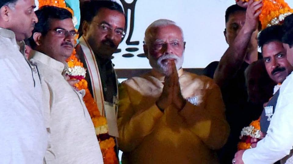 Prime Minister Narendra Modi being garlanded at an election rally in Varanasi on Sunday.