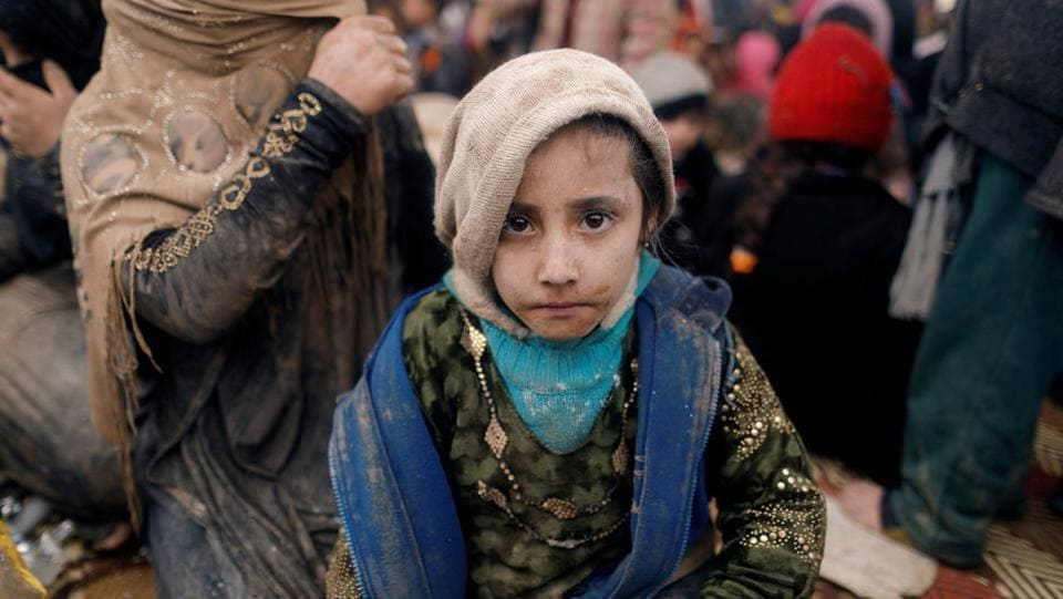 A displaced Iraqi girl who just fled her home sits at a processing centre. IS overran large areas north and west of Baghdad in 2014, but Iraqi forces backed by US-led air strikes and other assistance have since regained most of the territory they lost to the jihadists. (Zohra Bensemra/REUTERS)